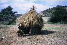 Mark Magreehan beside a hut on an Impala farm, Kenya