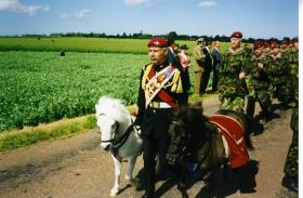 Mascots at head of parade during commemorations, c.1990s
