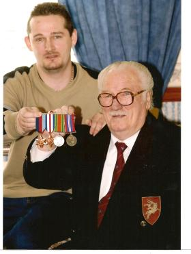 Charles J McClatchey after receiving his medals 56 years on.