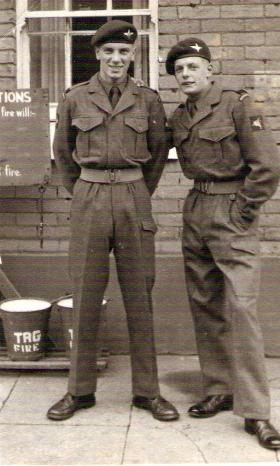 Pte H Wilson and 'unknown' going on first leave after basic training, 1954.