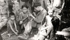 Medic attending the villagers, Borneo, 1965.