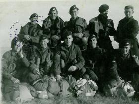 Members of 5th (Scottish) Parachute Bn on a DZ with field packed parachutes c1947