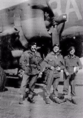 Members of 8th Battalion in front of a Dakota
