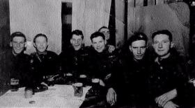 Members of 8th Battalion relaxing with a pint.