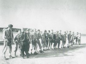 9 Airborne Sqn RE Personnel preparing for training jump in Palestine, 1947
