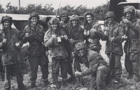 Members of the Machine Gun Platoon, 12 (Yorks) Para Bn on the DZ at Ranville, 6 June 1944