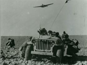 "Men of 16 Para Brigade take cover from ""enemy"" aircraft during training exercise, Jordan 1953"