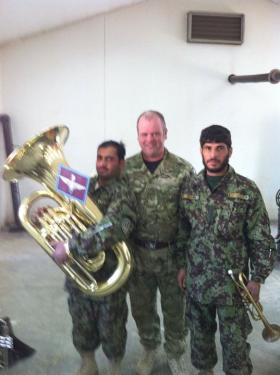 A member of the Parachute Regiment band mentoring Afghan National Army musicians Christmas 2010