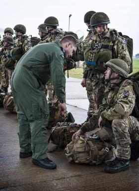 Paratroopers preparing to jump on Exercise Capable Eagle, 22 October 2013.