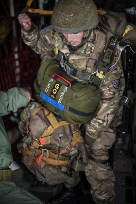 A Paratrooper is checked by a Parachute Jump Instructor on Exercise Capable Eagle, 22 October 2013.