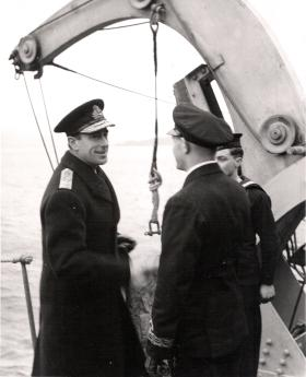 Lord Mountbatten talks with Commander HB Peate, HMS Prins Albert, after the operation, Bruneval, 1942.