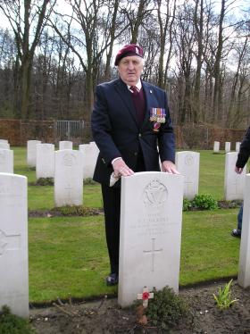 Mr L Rooke at the grave of Maj C Vickery, Reichswald Cemetery, 31 Mar 2010.