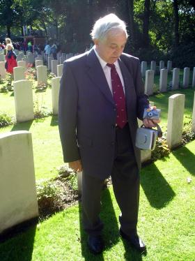 Stephen Morgan at the grave of Lt Grayburn VC, Oosterbeek, September 2005.