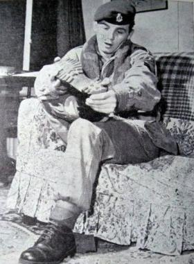 Pte Murphy gets ready to rest his feet, 23 PFA, Pegasus Journal, 1964.