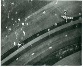 Many parachutes and a a Horsa glider landing north-east of Caen.