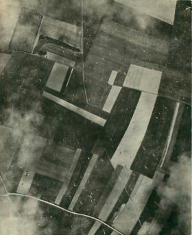 Ariel view of parachutes on drop zone at dawn on D-Day.