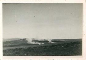 German patrol cars burning on the Beja road.