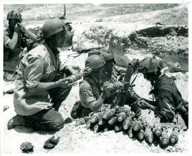 Men operating 3 inch mortars.