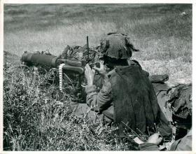 Paratrooper using a Vickers Medium Machine Gun.