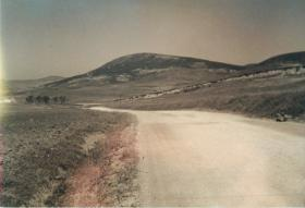 A dusty road leads to Green Hill, attacked by 3rd Parachute Battalion in March 1942.