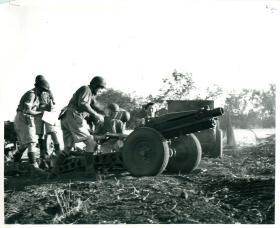 Airborne gunners operate a US 75mm pack gun.