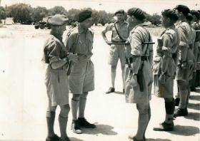 General Montgomery talks to a line of officers.