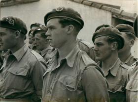 Men of 1st Airborne Division listen intently to General Eisenhower, c1942/3.