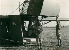 Men of the Border Regiment demonstrate method of unloading equipment from a Waco glider. June/July 1943.
