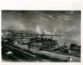 A heavy smoke screen is created to protect Allied shipping in Algiers Harbour.