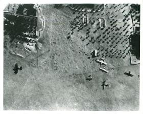 Aerial photo of Bone airfield shows German DF230 gliders and and Italian bomber on the ground.