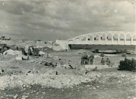 1st Parachute Squadron RE road building in front of a bridge.