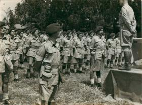General Eisenhower addresses 1st Parachute Brigade from a raised platform.