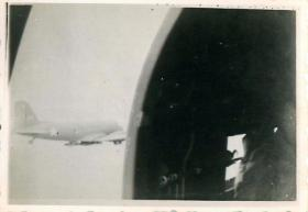 Photo taken from jumping door of Douglas Dakota aircraft. A second plane can be seen through the open door.