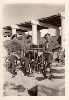 Pte Airey, Pte Robins and Driver Cable, 9th Airborne Squadron RE at the NAAFI Lido, Gaza Palestine. c1945.