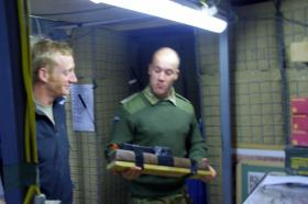 Maj Nick French 'looking suitably impressed' with an enhanced mousehole charge, Op Herrick XIII, November 2010.