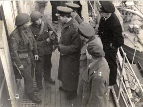 Gp Capt Sir Nigel Norman talks with Flt Sgt Cox after the operation, Bruneval, 1942.
