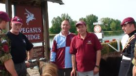 The Pathfinder Parachute Group 'Head Shed' with the regimental mascot at Pegasus Bridge, Normandy, 2010.
