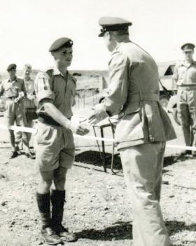 Cpl Macefield receives his cross country award from Gen Stockwell, Cyprus, c1960.