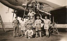Sgt Dick Southwood and members of 113 Sqn in front of a C47 under repair, RAF Aqir, Palestine, 1946