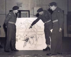 Officers of 16 Airborne Division discuss a mock attack on American forces at Upper Heyford airfield