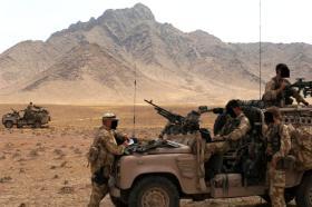 Using a laptop in a WMIK, Afghanistan, Op Herrick IV, 2006.