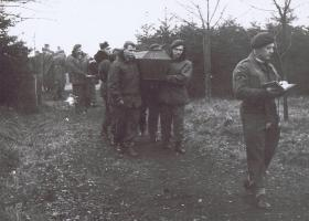 Father D McGowan leads the burial party, February 1945.