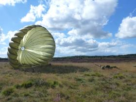 A paratrooper lands on Ginkle Heath during the 68th anniversary of Arnhem, 22 September 2012.