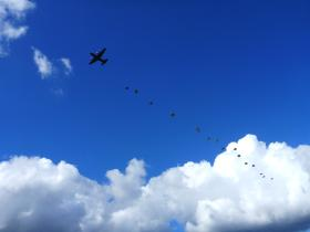 Paratroopers descend from a Hercules onto Ginkle during 68th anniversary of Arnhem, 22 September 2012.