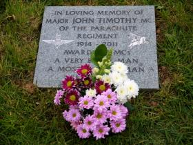 Images of the memorial stone for Maj John Timothy MC, Timberscombe, 2012.