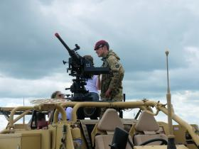 Pte Miles Davis exhibiting the Coyote to members of the public at IWM Duxford 17 June 2012