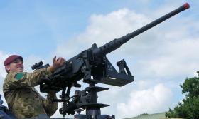 Cpl Logan 3 PARA demonstrating a .50 cal machine gun to members of the public at IWM Duxford, 17 June 2012.