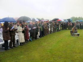 Bedraggled VIPs at the service of dedication for the Airborne Forces National Memorial, NMA 13 July 2012.