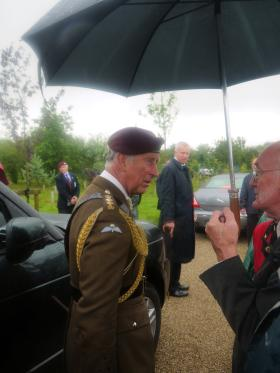 HRH Prince of Wales talks to veterans at the National Memorial Arboretum, 13 July 2012.