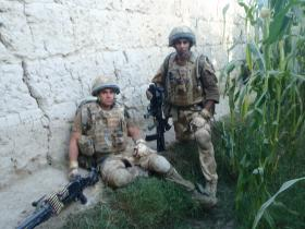 Members of 2 PARA pause following close quarters contact during a foot patrol near FOB Inkerman, Afghanistan, 2008
